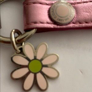 Coach Bags - Coach pink metallic strap with daisy charm